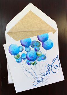 Blue Balloon Watercolor. This beautiful watercolor is a one-of-a-kind work of art.  Each card is made to order on our custom engraved, Arzberger stationary.  These beautiful hand-painted greeting cards will be the most precious card you have ever given. It IS the gift. Dazzling Swarovski crystals are delicately placed with some added sparkle to make this beautiful art piece something that will be remembered for years to come