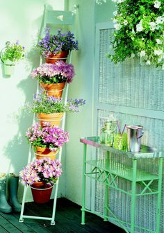 For a balcony or a small space! This would be cute using an antique ladder.