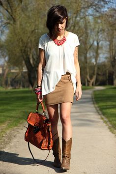 This is such a cute outfit: The brown cowboy boots are awesome! Also, the bright pop of color with the jewelry is awesome!