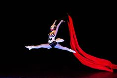 Ballet dancer with ribbon under UV light. Crystal Light Show. http://antaagni.com/crystal-light-show/