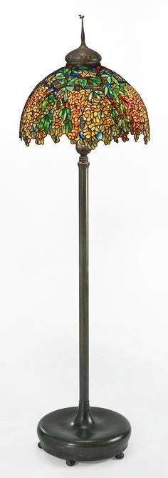 "TIFFANY STUDIOS ""Laburnum"" Floor Lamp Estimate $250,000 - $350,000 79 in. (200.7 cm) high<br />24 1/2  in. (62.2 cm) diameter of shade leaded glass and patinated bronze"