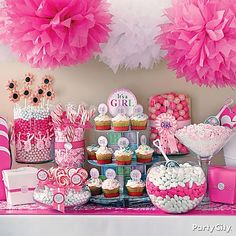 Lots of supercute It's a Girl baby shower candy buffet ideas, in perfect pink and white.