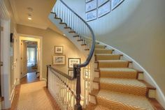 townhouse staircase with stark runner