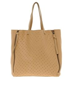 Asos Leather Punchout Tote featuring twin handles, a punch out panel to the front, twin extender zipped fastenings to side, large interior compartment with a zipped pocket. A tote bag refers to a large and often unfastened bag, with parallel handles that emerge from the sides of its pouch. FD1A1 Candy Lee