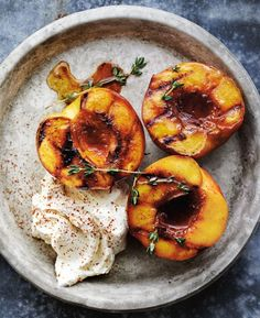 Honey Glazed Roasted Peaches with Mascarpone | When peaches are at their seasonal peak, they can speak for themselves with only a few added flavorings. In this simple recipe, they are roasted with honey to bring out their juices, and served with a dollop of creamy mascarpone as a simple dessert. If you like, serve the peaches with shortbread cookies.