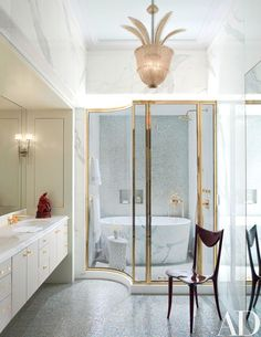 In the master bath are sink and shower fittings by Drake for THG, a vanity sheathed in an Edelman leather, and mosaic tiles by Sicis; the vintage Seguso ceiling light is from Bernd Goeckler Antiques | archdigest.com