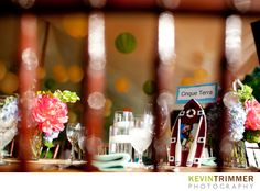 Wedding reception table setting with centerpiece and colorful paper lanterns. www.kevintrimmer.com