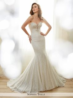 Sophia Tolli - Y11708 Angelique - Strapless allover shimmer lace and soft tulle over corded metallic lace trumpet gown features a plunging sweetheart neckline with peekaboo semi-concealed by hand-beaded lace detail, back corset trimmed with matching lace detail, chapel length train. Removable spaghetti and halter straps included.Also available with back zipper trimmed with diamante buttons and loops as Y11708ZB.Sizes: 0 - 28Colors: Light Champagne/Silver, Diamond White/Silver