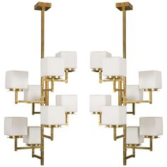 Pair of Eight-Arm Chandeliers   From a unique collection of antique and modern chandeliers and pendants at https://www.1stdibs.com/furniture/lighting/chandeliers-pendant-lights/