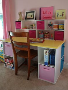 DIY Desk for Kids - Assembled. I hacked up some ClosetMaid cubes into a great little desk for Lily. There's finally a place to put all of her stuff.