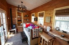 The Nomad's Nest is a gooseneck tiny house created by Wind River Tiny Homes. This house was featured in the second season of Tiny House Nation on FYI. Tiny House Big Living, Tiny Living Rooms, Tiny House Plans, Tiny House On Wheels, Small Living, Living Area, Tiny House Layout, Tiny House Design, Tiny House Furniture