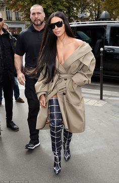 Insolvency: Kim Kardashian's bodyguard Pascal Duvier, pictured above with Kim in Paris last weekend, filed for bankruptcy for his German security company ten weeks ago with debts of more than €1million