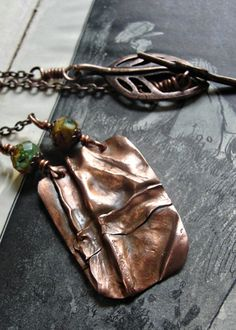 Fold-formed copper pendant--I really like the designs of fold-forming.