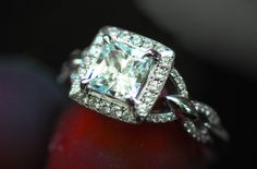 This ring features a princess cut center diamond and a chain link effect.  Beautiful!! www.durnell.com www.karatsburgh.com