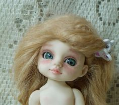 Oooh!  What a cutie!  Natural colour Thistledown by SleepingElf on Etsy.