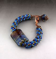 Beaded kumihimo bracelet with lampwork beads. by thequiltedbead, $75.00