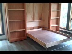 I really want a Murphy bed on the landing space for guests. or naps Murphy Bed (Wall Bed) hidden behind two bookshelves that push aside to reveal bed unit. Murphy Bed Bookcase, Bookcase Wall Unit, Office Bookshelves, Murphy-bett Ikea, Bed Unit, Diy Bett, Modern Murphy Beds, Murphy Bed Plans, Style Deco