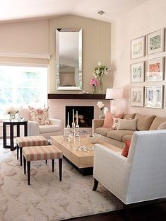 With a tall mantle, a full length mirror was used over the fireplace.  A pendant light is directed on the flower arrangement  looks well though out.