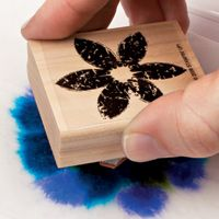 1) Squeeze a few drops of ink on a baby wipe; the moistened material absorbs the colors and creates a unique ink pad. 2) Stamp your image. 3) For another approach, gently swipe the wipe over your card stock to create a multicolored background