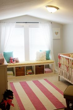 After all of the inspiration on Pinterest I came up with this for my baby girl's nursery. The color scheme is pink, yellow/gold and teal. The walls are painted a light gray. There is a lot of striped and chevron or zig zag pattern through out. Bench cushion is custom made.