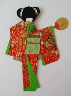 This is a traditional Japanese dancing Geisha girl, wearing red Kimono (traditional clothes) and have hair decoration for the doll. she is dancing