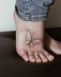 Butterfly tattoo on the right foot.