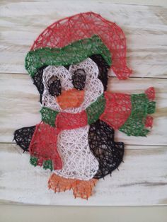 Christmas Penguin string art. Check us out on Facebook at All Strung Up. https://www.facebook.com/pages/All-Strung-Up/915873695199667?ref=hl