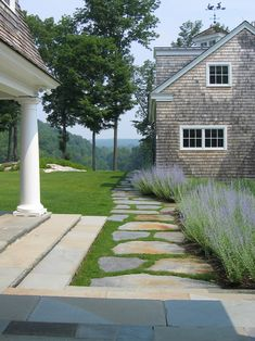 Extra flagstones from our patio project would be perfect for the pathway on the side yard! Love the grass between the stones, to provide a subtle, soft difference from the hard flagstone patio in the back. Extra flagstones from our patio