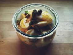 Fruit salad of pear, apple, and banana with plain yogurt and pistachio.