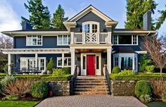 feng shui home design with red exterior door