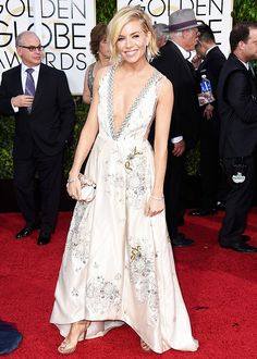 Sienna Miller wears Miu Miu at the 72nd Annual Golden Globe Awards Post-Party on Jan. 11, 2015 in Beverly Hills, California