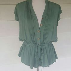 Light olive green blouse Beautiful detailed blouse.  Buttons up the front and ties at the waist. Lace detail on shoulders and across back.  Size 2xl.  Runs small. mine too Tops Blouses