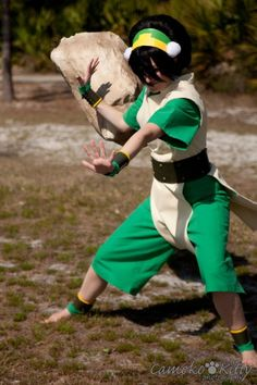 Awesome cosplay of Toph from Avatar. Apparently they had to throw that rock a lot to get this great shot.