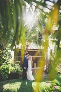 Bride and Groom at water tower at Coco Palms http://amauiweddingday.com