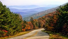 The Talimena National Scenic Byway, a breathtaking 54-mile route in southeast Oklahoma, is known for its spectacular fall foliage. Make your way to this winding road nestled in the heart of Oklahoma's Kiamichi Country to view one stunning panorama after another as you travel along crests of forested peaks.