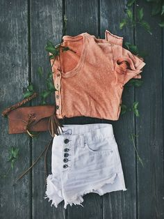 Orange Top and Pale Shorts via