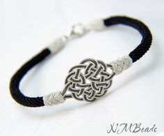Here is an elegant, hand woven Celtic sun knot bangle bracelet . I use many of the traditional techniques in my designs. This bracelet is one of them. For this design, i used Celtic sun knot motif and cylinder-shaped Turks head knots and black silk jewelry cord. The motif and Turks head knots are hand-tied with Kazaz Wire. One strand of sun knot is oxidized. It has a 925K sterling silver lobster clasp . This bracelet looks absolutely beautiful. It is elegant enough for the most special o...
