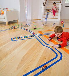 The best play space of all may be an empty expanse. Give your kids a roll or two of painter's tape and let their sense of make- believe take over, a la Harold and the Purple Crayon. Roads and farms, four-square courts and hopscotch boards: anything is possible. The low-stick tape can be used on most carpeting and flooring (and furniture too!), comes in several different colors (we've found blue, green, and yellow), and can be removed without a trace when playtime is over.