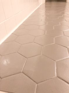 Before you rip out your ugly bathroom tile, you should read this! We changed our bathroom tile for $150 bucks and it looks amazing! Painting Old Bathroom Tile, Tub And Tile Paint, Hexagon Tile Bathroom, White Bathroom Tiles, Tub Tile, Tile Painting, White Tile Paint, Tile Bathroom Floors, Floor Grout