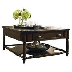 Lift-top coffee table with one drawer and a lower display shelf.Product: Coffee tableConstruction Material: Popla...