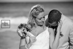 Black and white kiss. Amazing newlyweds with the bride & groom on the beach. Beach Palace Cancun Wedding Photographer. Unique photography in Mexico. Best Destination Riviera Maya Wedding ideas. Trash the Dress. Playa del Carmen MTM Photography.