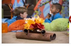 Table decor for Madi's camp theme party - credit to Michaels website
