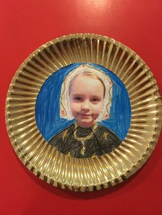 Tudor miniatures- KS2 Art. Gold plates with an aperture cut out, square piece of paper that will fit behind aperture, photos of children cut out that fits on paper. Children then use pictures of Tudor miniatures to inspire them to draw their own. They look great displayed on the wall, like in a gallery.