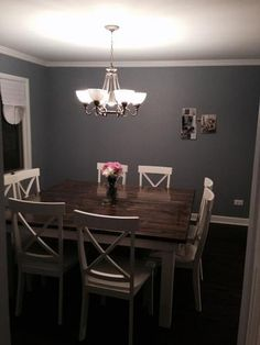 "66"" x 66"" Square Farmhouse Table in Vintage Industrial Grey and Ivory with matching X-Back Chairs."