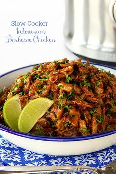 Slow Cooker Indonesian Shredded Chicken - throw everything in the slow cooker and your work is done. The magic comes next as the chicken and sauce are melded together and the result is super tender, crazy delicious barbecue chicken!