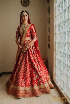 Looking for Red and gold bridal lehenga with floral work embroidery? Browse of latest bridal photos, lehenga & jewelry designs, decor ideas, etc. on WedMeGood Gallery.