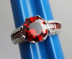 Stunning-Red-Stone-Costume-Ring-Silvertone-Band-with-Fancy-Accents-Size-7