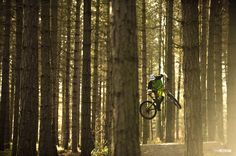 Photo of Josh Lewis in Yorkshire, United Kingdom. Style for miles. Josh Lewis weaving his bike sideways through the trees of Wharncliffe.