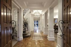 foyer... great trim work on the columns and ceiling