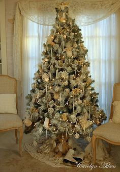 The loveliest white Christmas tree from Aiken House & Gardens: The Christmas Cottage